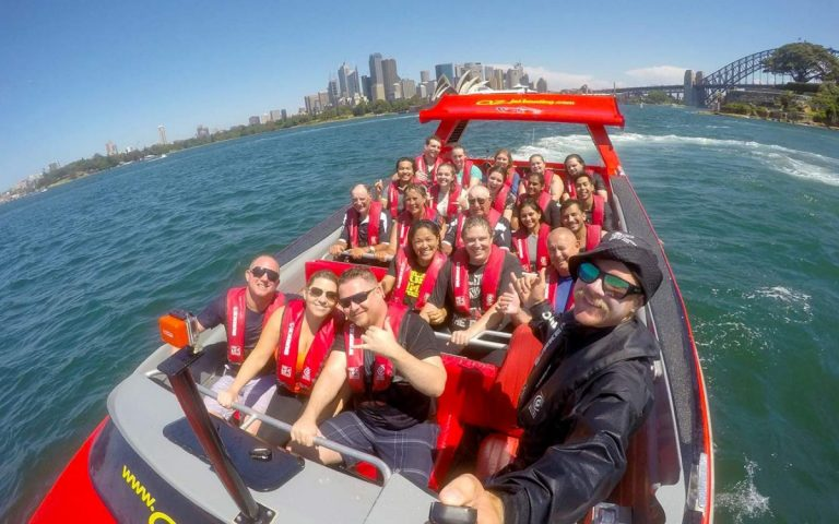 Oz Jet Boating selfie shot of skipper and passengers on Sydney Harbour